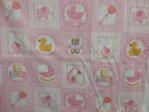 pink squares with rattle, rubber duck, cradle, letters