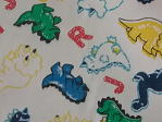Dinosaurs with yellow green blue alphabet