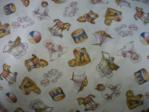 baby fabric with rocking horses, drum, pram swatch